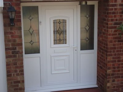 Front door with combination frame