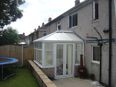 Conservatory to the rear, back door and windows
